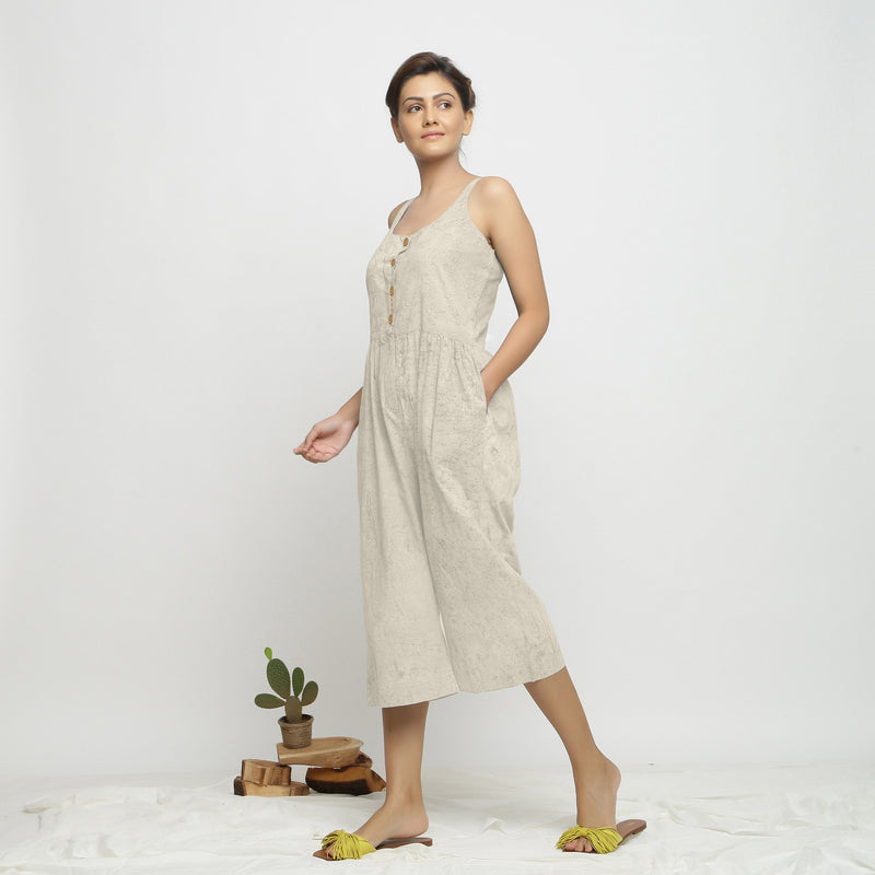 Left View of a Model wearing Beige Dabu Printed Button-Down Jumpsuit