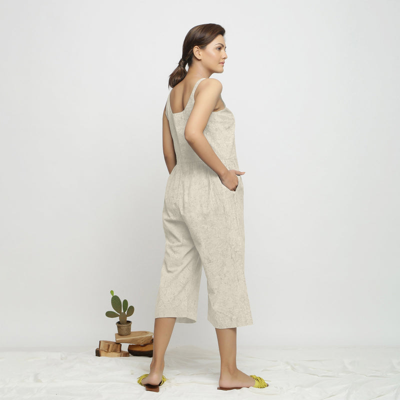 Back View of a Model wearing Beige Dabu Printed Button-Down Jumpsuit