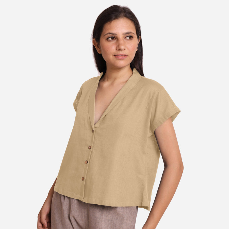 Left View of a Model wearing Beige Deep Neck Button-Down Cotton Top