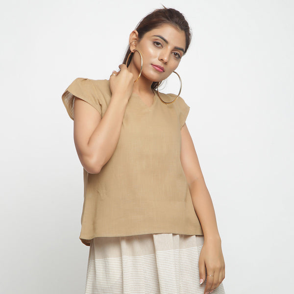 Front View of a Model wearing Beige Puff Sleeves Cotton A-Line Top