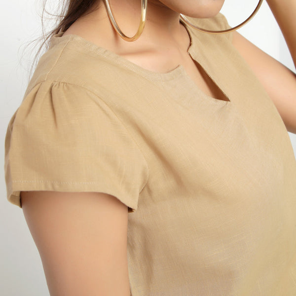 Front Detail of a Model wearing Beige Puff Sleeves Cotton A-Line Top
