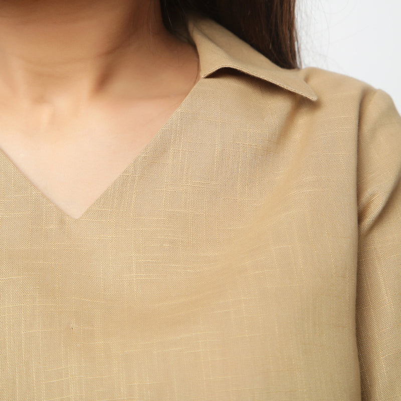 Front Detail of a Model wearing Beige Bracelet Sleeve Straight Top