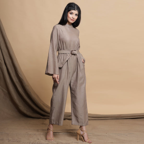 Right View of a Model wearing Beige Flared Sleeve Gathered Jumpsuit
