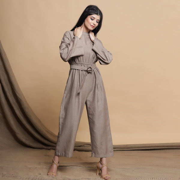 Front View of a Model wearing Beige Flared Sleeve Gathered Jumpsuit