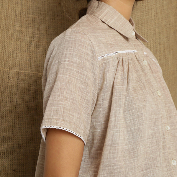 Right Detail of a Model wearing Beige Handspun Comfort Fit Balloon Top