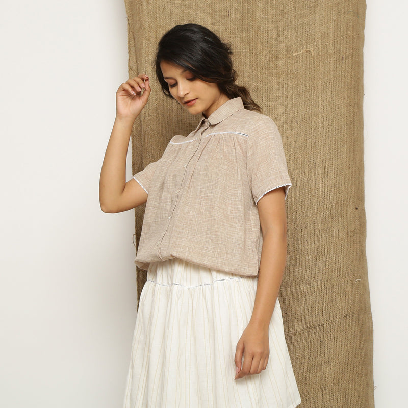 Left View of a Model wearing Beige Handspun Comfort Fit Balloon Top