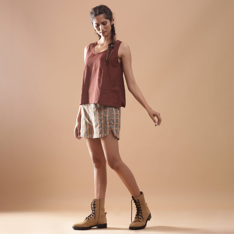 Left View of a Model wearing Beige Kalamkari Comfort Fit Shorts