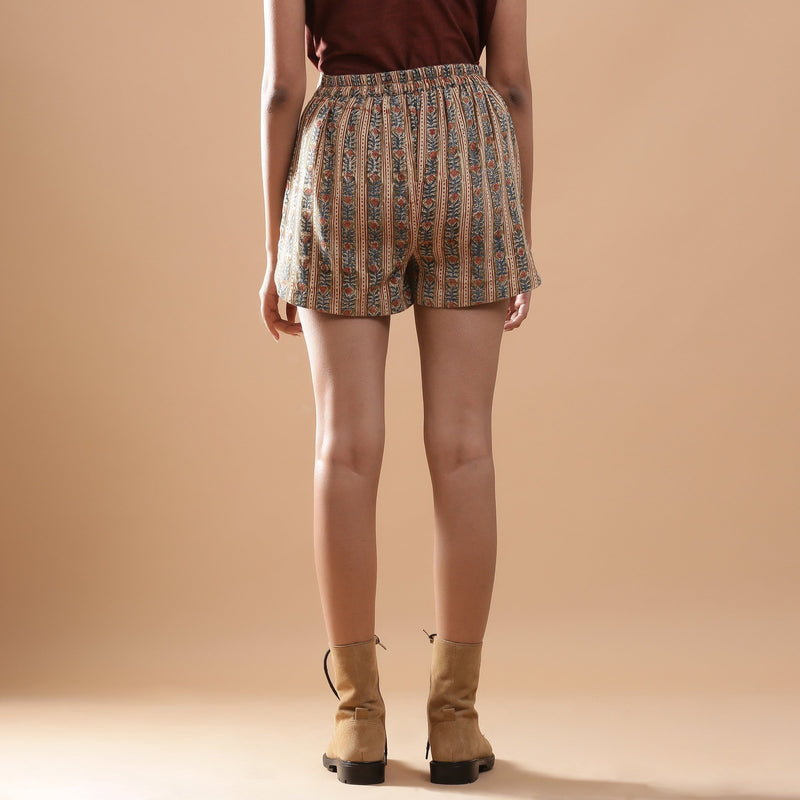 Back View of a Model wearing Beige Kalamkari Comfort Fit Shorts