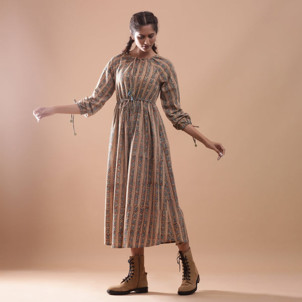 Front View of a Model wearing Beige Kalamkari Peasant Midi Dress