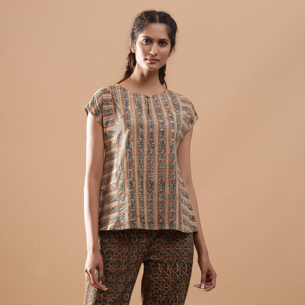 Front View of a Model wearing Beige Kalamkari A-Line Striped Top