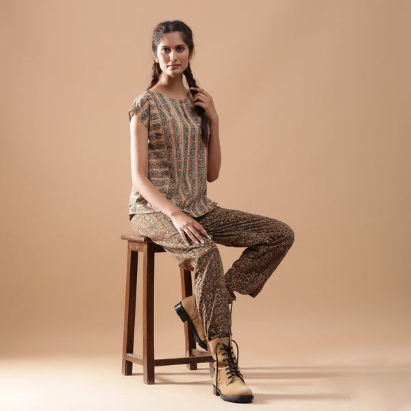 Right View of a Model wearing Beige Kalamkari A-Line Striped Top