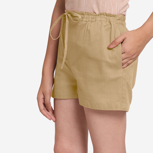 Left View of a Model wearing Beige Mid-Rise Cotton Straight Shorts