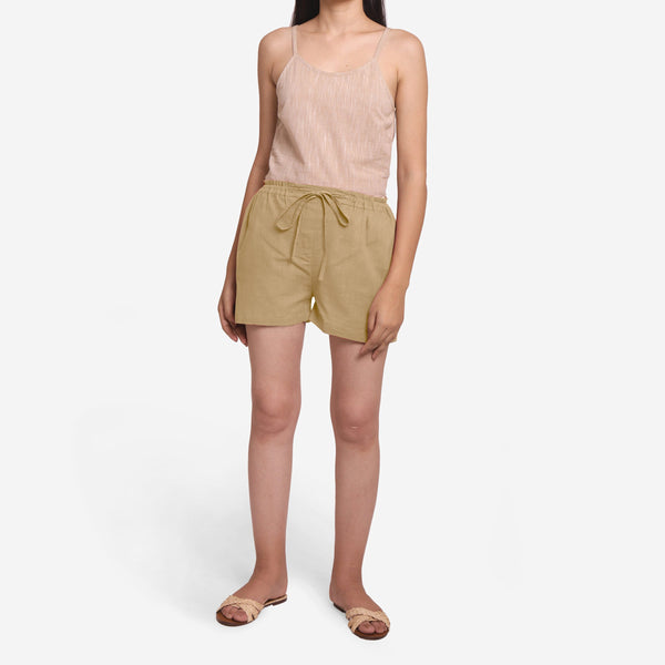Front View of a Model wearing Beige Mid-Rise Cotton Straight Shorts