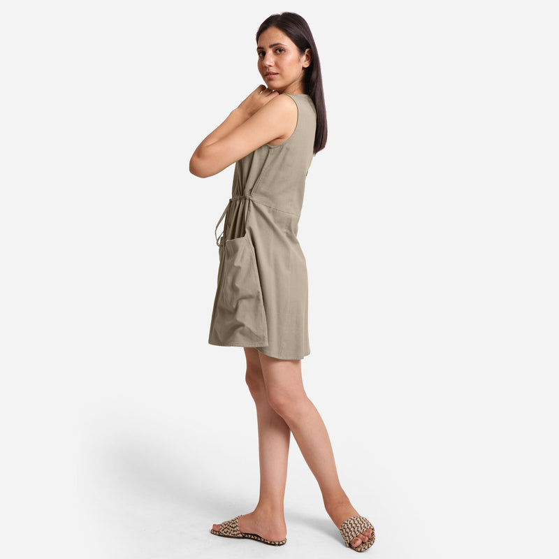 Left View of a Model wearing Beige Patch Pocket Round Neck Dress