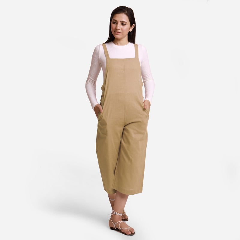Front View of a Model wearing Beige Pinafore Midi Length Dungaree