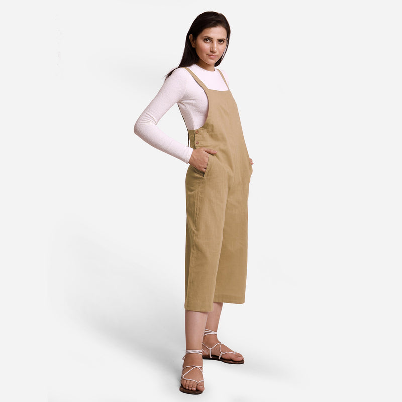 Right View of a Model wearing Beige Pinafore Midi Length Dungaree