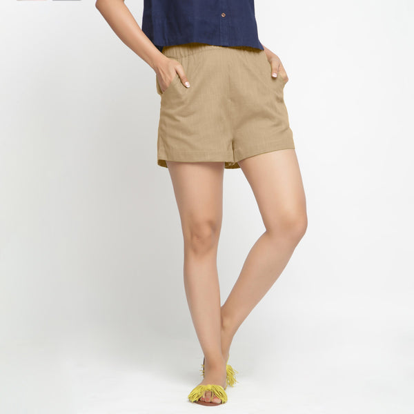 Front View of a Model wearing Beige Solid Cotton Short Shorts