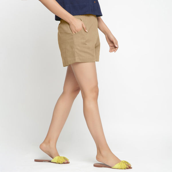 Right View of a Model wearing Beige Solid Cotton Short Shorts