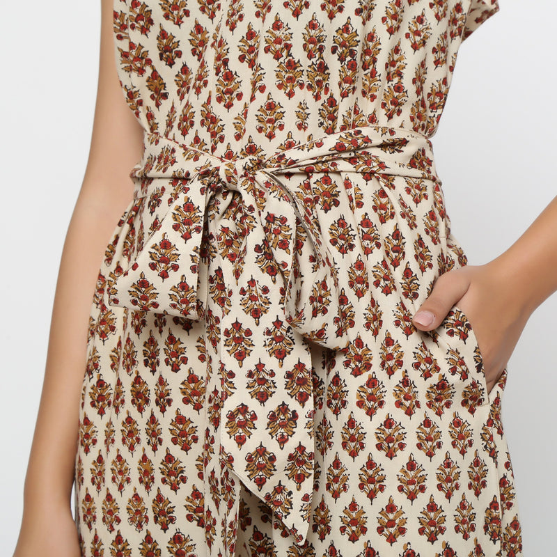 Close View of a Model wearing Bagru Print Beige Floral Jumpsuit