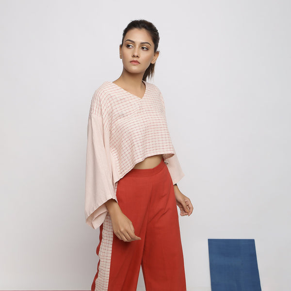 Right View of a Model wearing Pink Vegetable Dyed V-Neck Crop Top