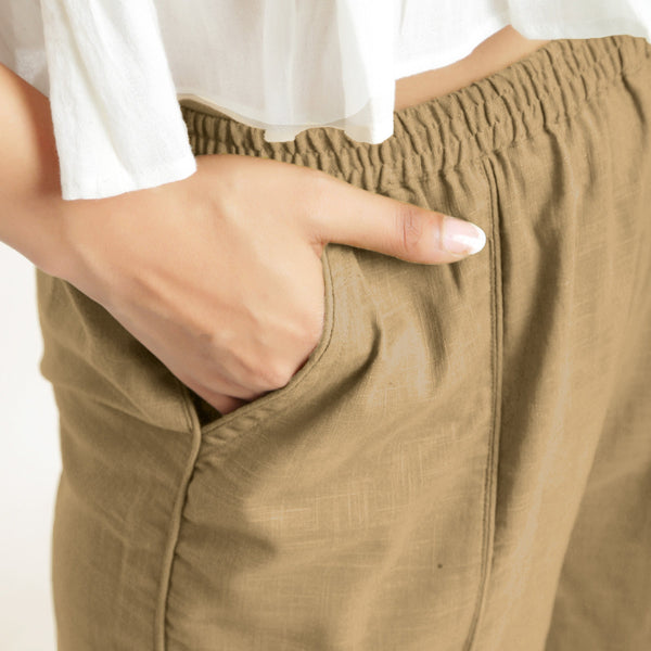 Front Detail of a Model wearing Beige Wide Legged Straight Pant
