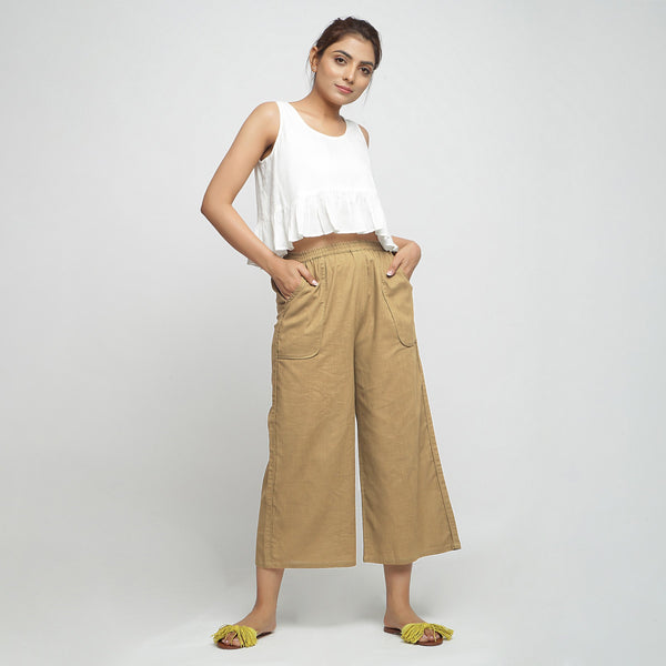 Front View of a Model wearing Beige Wide Legged Straight Pant