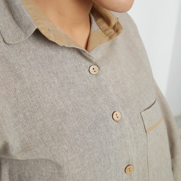 Front Detail of a Model wearing Beige Yarn Dyed Knife Pleats Top