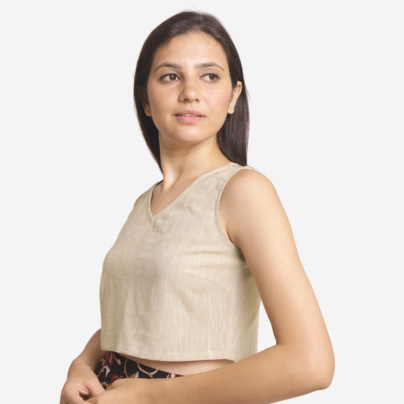 Left View of a Model wearing Solid Beige Yarn Dyed Cotton Crop Top