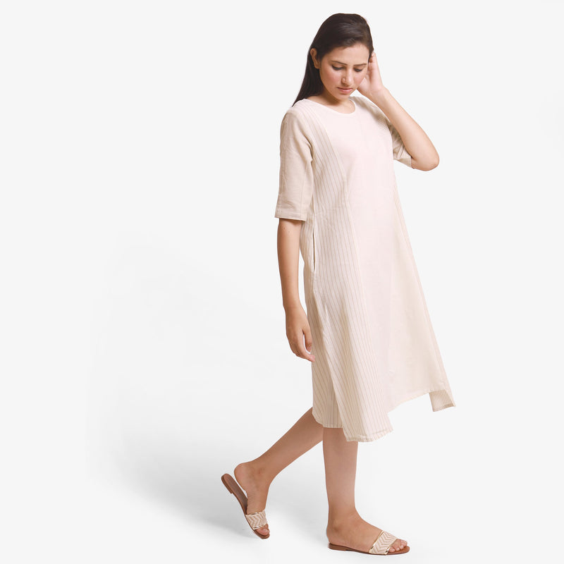 Right View of a Model wearing Beige Yarn Dyed Cotton Paneled Dress