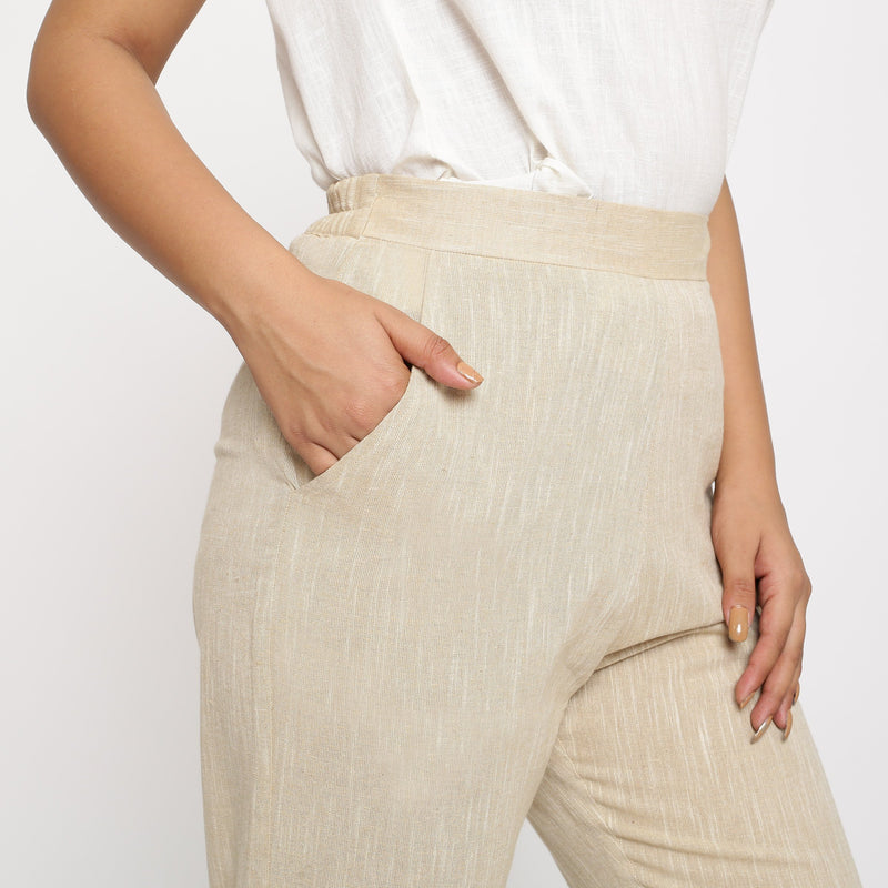 Right Detail of a Model wearing Beige Yarn Dyed Mid Rise Tapered Pant
