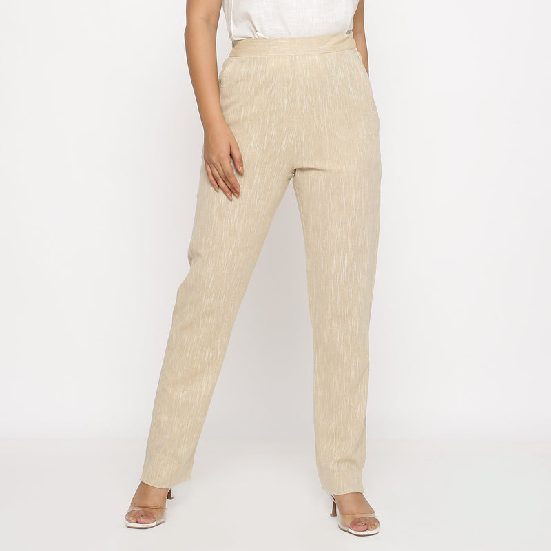 Front View of a Model wearing Beige Yarn Dyed Mid Rise Tapered Pant