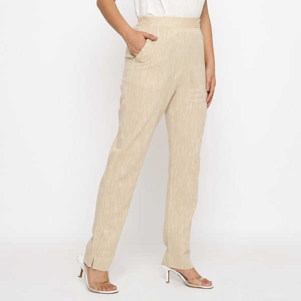 Right View of a Model wearing Beige Yarn Dyed Mid Rise Tapered Pant