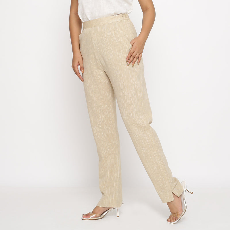 Left View of a Model wearing Beige Yarn Dyed Mid Rise Tapered Pant