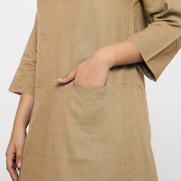 Front Detail of a Model wearing Beige Yoked Cotton Tunic Dress