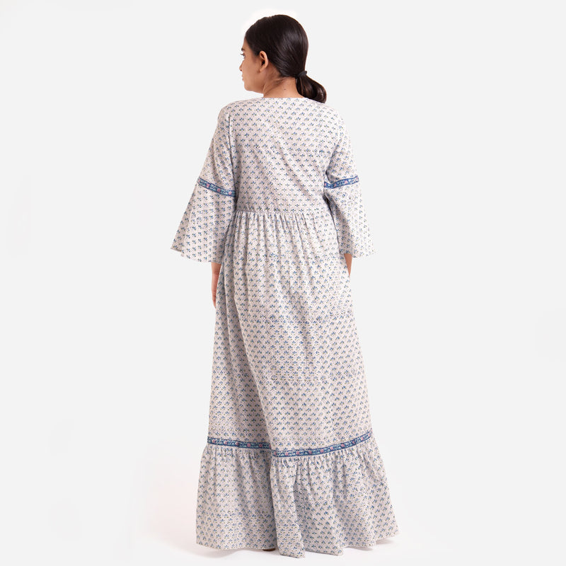 Back View of a Model wearing Blue Block Printed Bell Sleeves Tier Dress