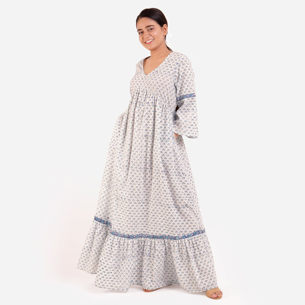Left View of a Model wearing Blue Block Printed Bell Sleeves Tier Dress