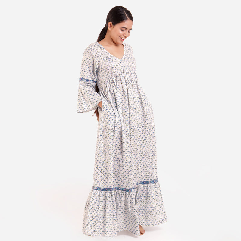 Right View of a Model wearing Blue Block Printed Bell Sleeves Tier Dress