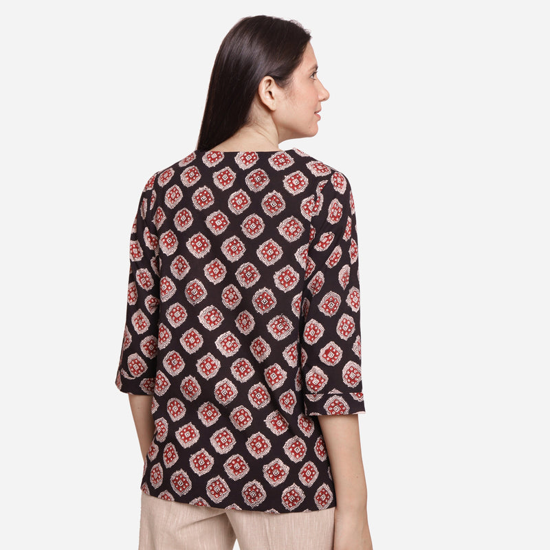 Back View of a Model wearing Black Bagru-Printed Shawl Collar Top