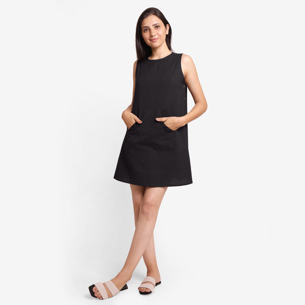 Front View of a Model wearing Black Cotton Flax Kangaroo Pocket Dress