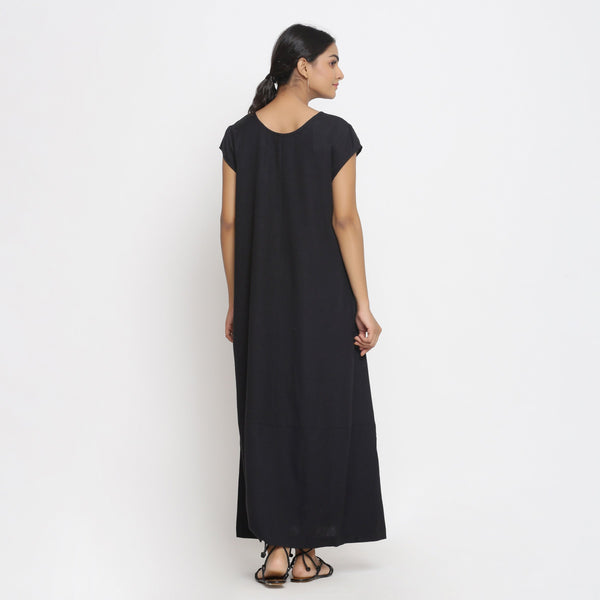 Back View of a Model wearing Black Cotton Flax Paneled A-Line Dress