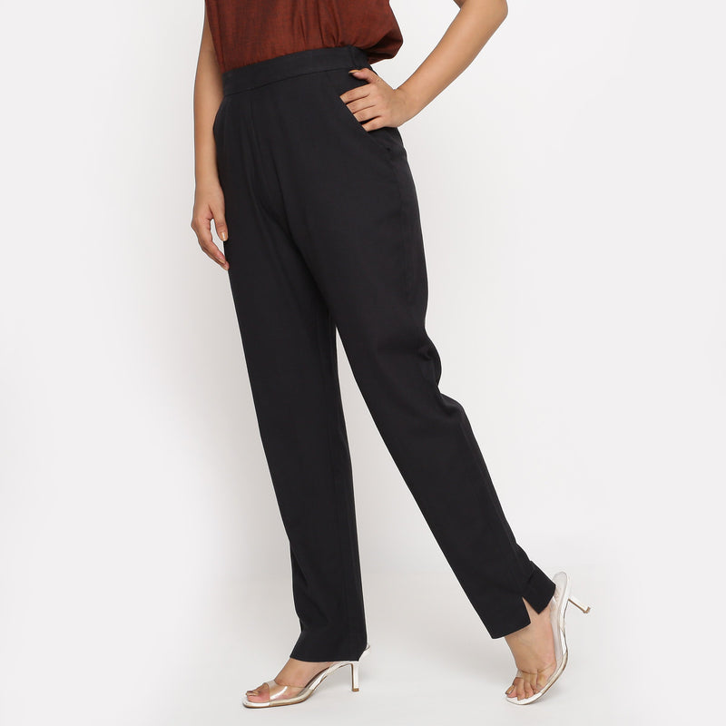 Left View of a Model wearing Solid Black Cotton Flax Straight Pant