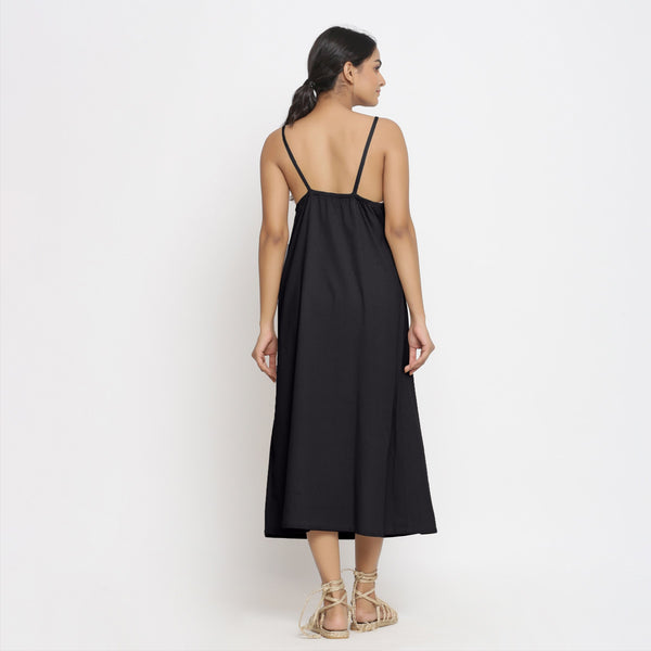Back View of a Model wearing Black Cotton Flax Strap Sleeve A-Line Dress