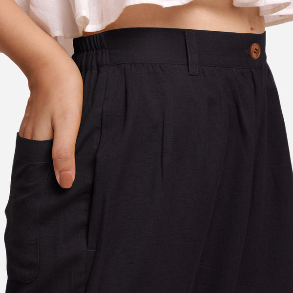 Right Detail of a Model wearing Black Cotton Flax Wide Legged Straight Pant