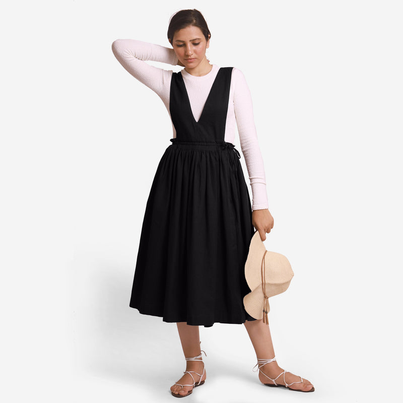Front View of a Model wearing Black Deep Neck Pinafore Midi Wrap Dress