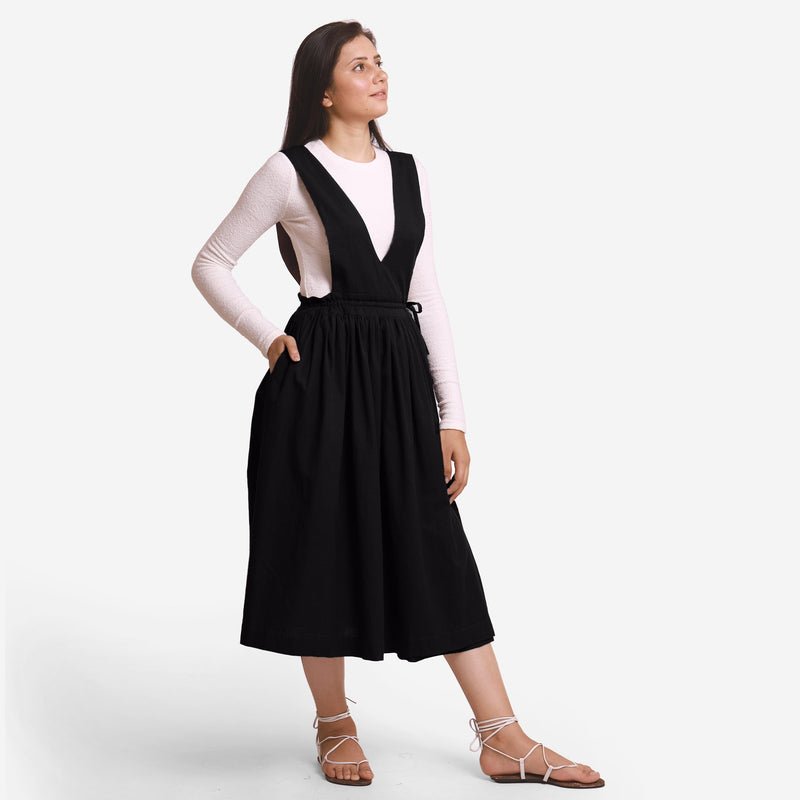 Right View of a Model wearing Black Deep Neck Pinafore Midi Wrap Dress