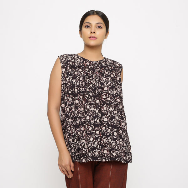 Front View of a Model wearing Bagru Floral Print Black Gathered Yoke Top