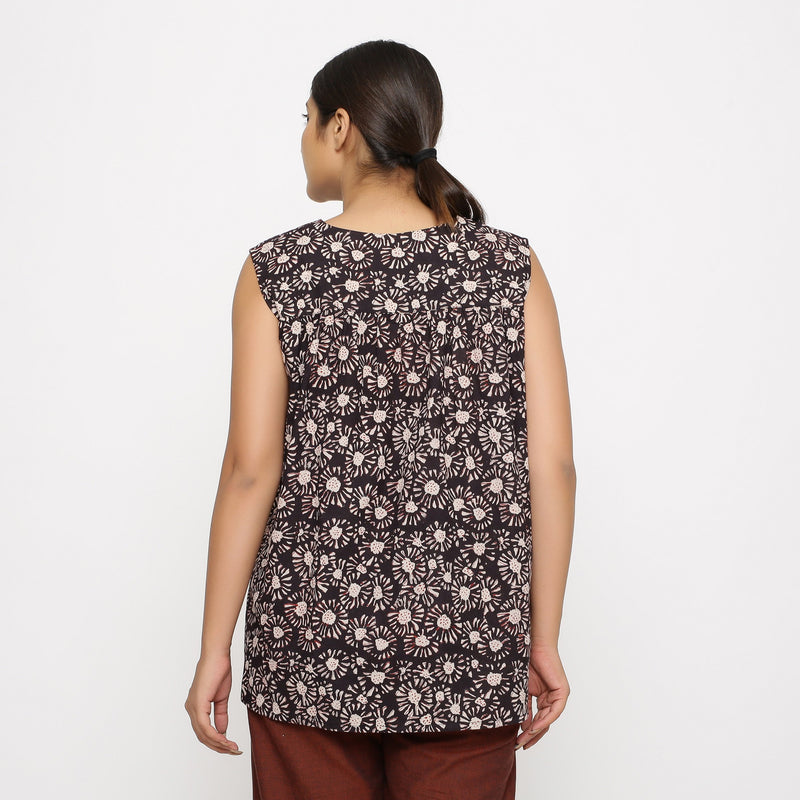 Back View of a Model wearing Black Floral Sleeveless Top