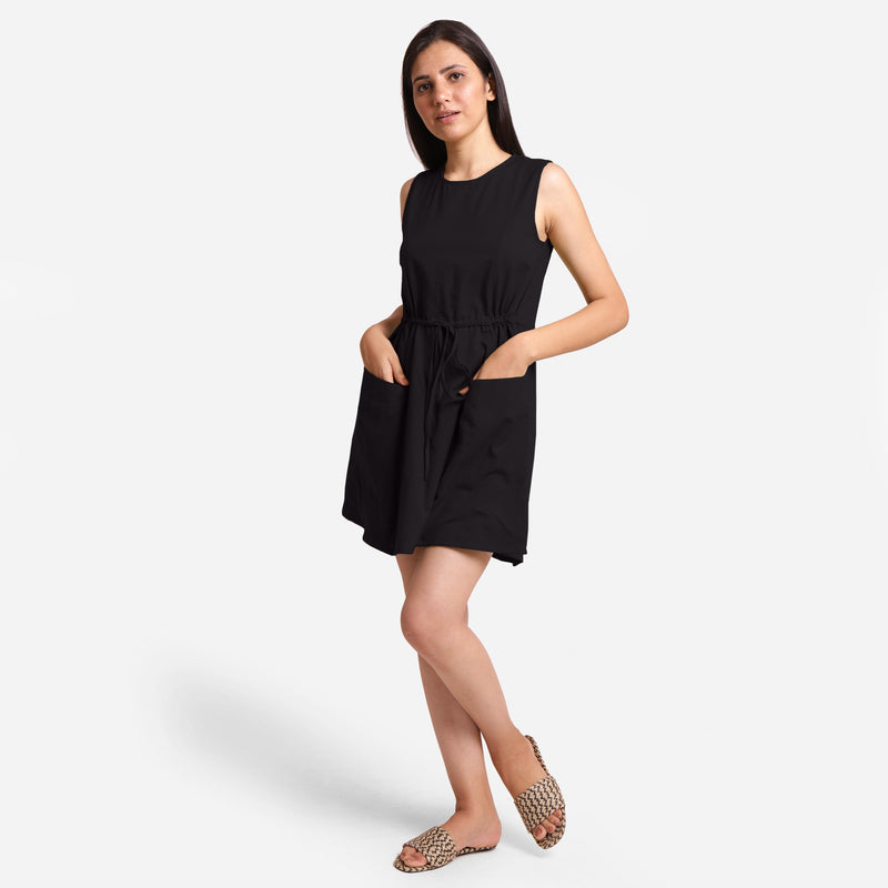 Front View of a Model wearing Black Patch Pocket Round Neck Dress