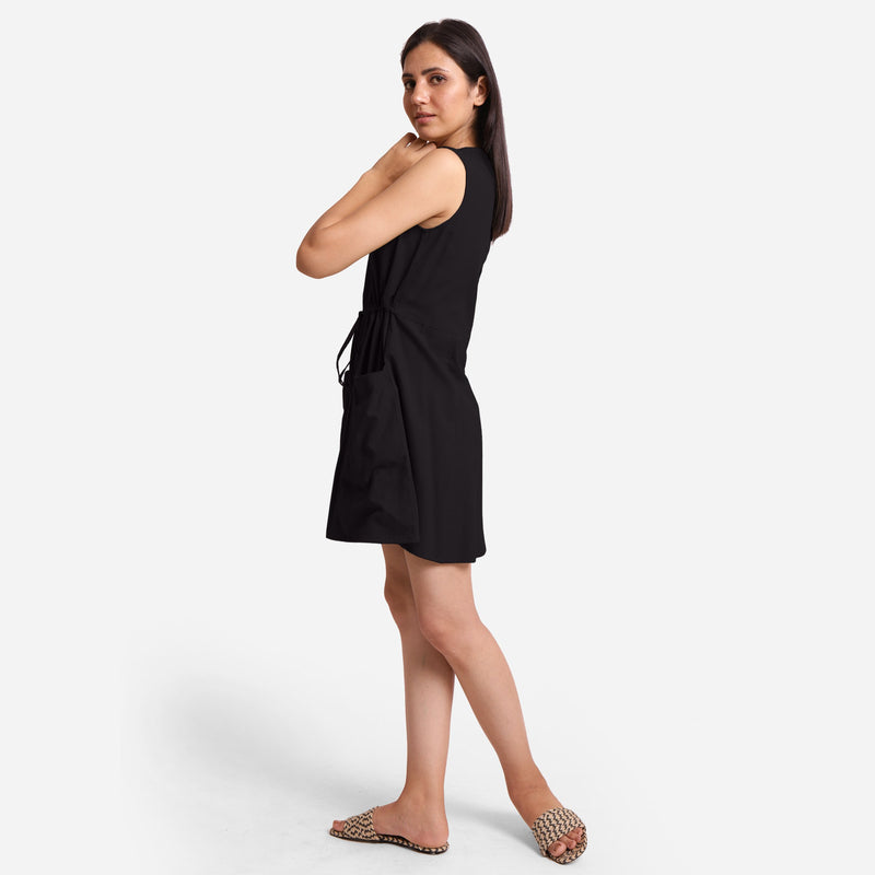Left View of a Model wearing Black Patch Pocket Round Neck Dress