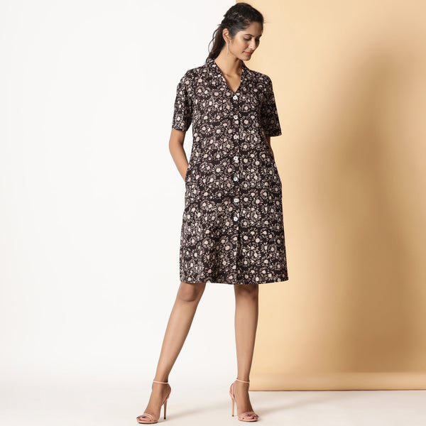 Front View of a Model wearing Block Printed Black Floral Button-Down Dress